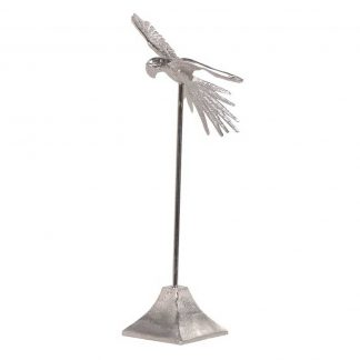 Flying bird on a stand